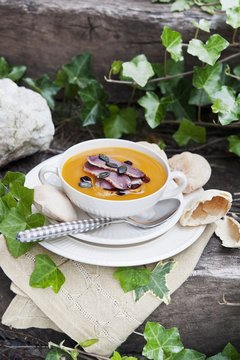 Baked pear and pumpkin soup with smoked duck breast