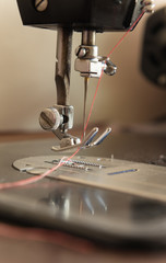 Sewing machine needle on vintage tone