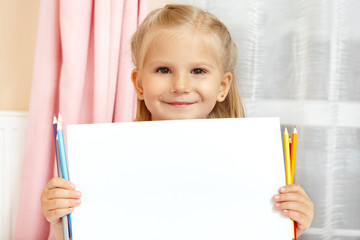 Adorable little girl with pencils