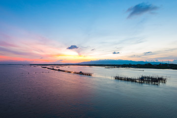 Thai's traditional fish baskets and morning landscape view from the bridge (Taksin Maharat Bridge) in Chonburi province, Thailand.