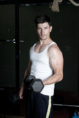 Fitness Trainer training his bicep at the gym