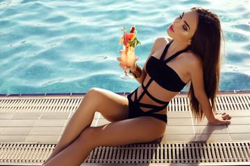 sensual woman with dark hair wearing elegant bikini,