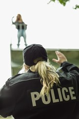 Policewoman with megaphone helping girl