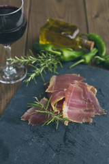 serrano ham with rosemary  oil and peppers