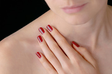 Young beauty with polished red finger nails