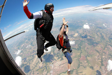 Skydiving friends jumping from the plane