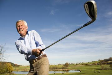 Senior adult man holding golf club