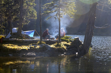 Man and woman camping on small island