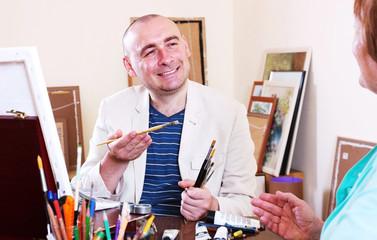 Happy artist draws