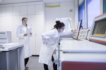 Laboratory assistant checking laboratory device