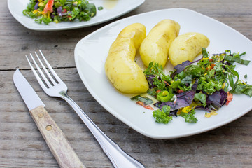 herbs and potatoes / Boiled potatoes with butter and colorful garden herbs