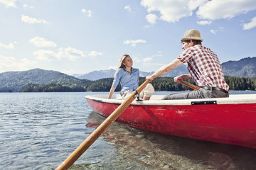 Germany,Bavaria,Couple in rowing boat,smiling
