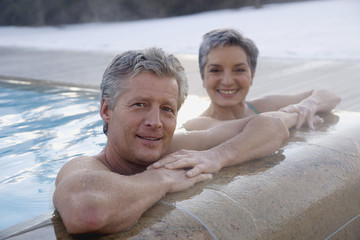 Mature couple relaxing in outdoor spa,portrait