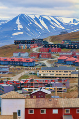 Looking over numerous colorful buildings, in Longyearbyen, Svalb