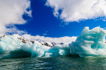 Close up of blue green icebergs floating in a fjord in Svalbard,