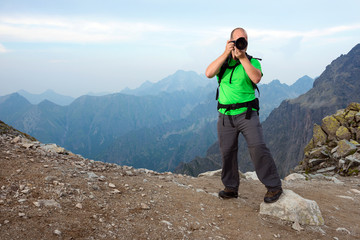 Photographer taking a photo in the mountains
