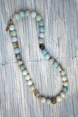 Necklace on old wooden table