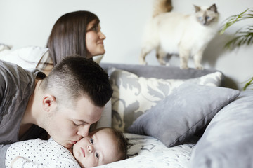 Young family with cat in living room