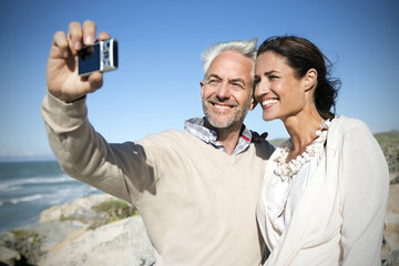 South Africa, smiling couple taking a selfie head to head