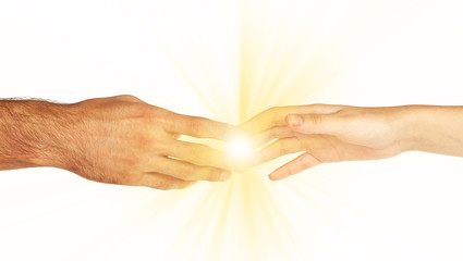 Fototapete - Woman and man hand attracted to each other with light isolated on white
