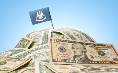 Flag of Louisiana sticking in a pile of american dollars.(series
