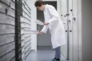 Laboratory assistant in sample archive of clinical laboratory