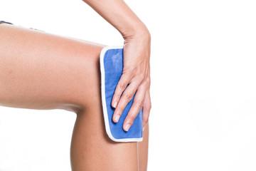 Fototapeta woman applying cold pack on swollen hurting knee