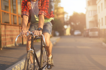Close up hipster on bike in the city at sunset. Shot with Wall mural