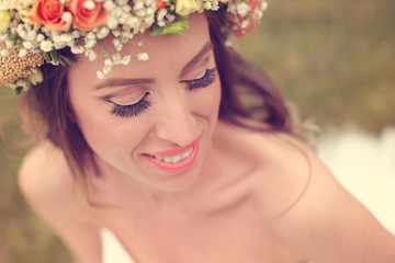 Beautiful bride wearing make up and a floral crown