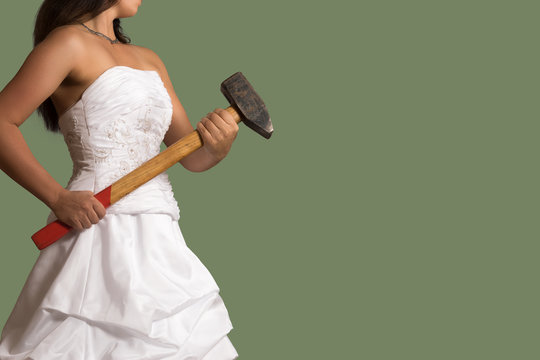 Young confident bride with a sledgehammer