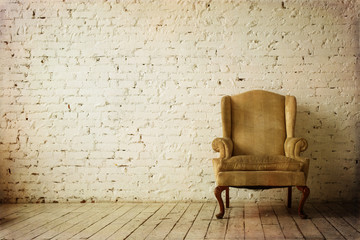 Old Retro Armchair against White Brick Wall Interior
