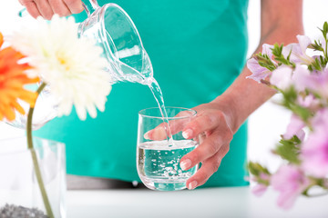 Woman pouring water into a glass