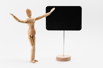 Wooden mannequin pointing on a canvas, as presenting something