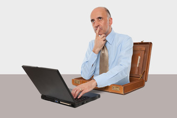 Business man working with his laptop at desk