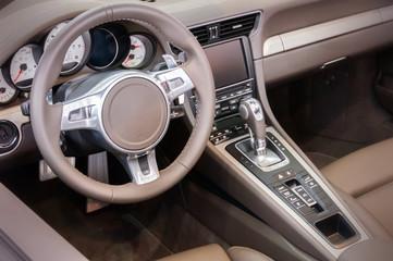 Dark luxury car Interior - steering wheel, shift lever and dashb