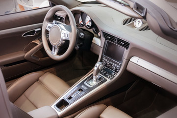 Dark luxury car Interior - steering wheel, shift lever and dashb