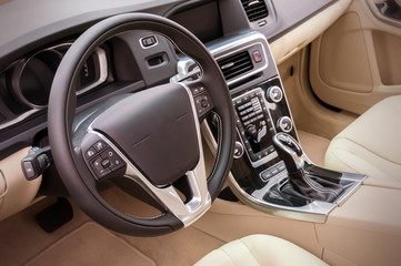 Black luxury car Interior - steering wheel, shift lever and dash