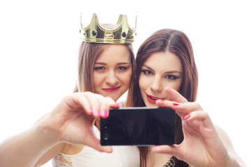 two young funny women taking selfie