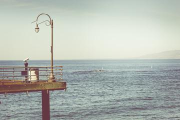 Retro vintage filtered nostalgic picture of promenade against su