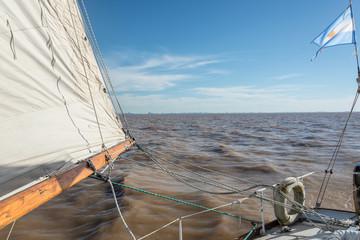Sailing Buenos Aires city. Argentinean Flag waving at Rio de la