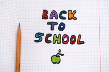 Colorful Back To School phrase and pencil