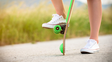 Anonymous teenage girl with skateboard