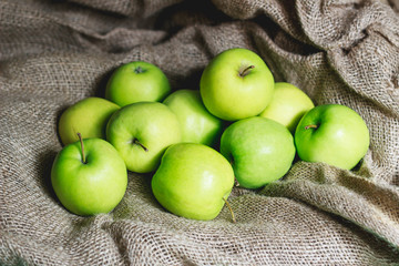 Green apples on brown suck