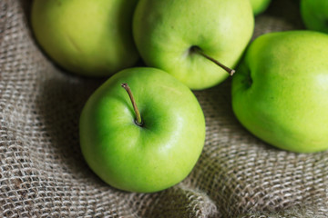 Green apples on brown suck
