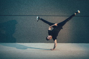 BBoy doing handstand on street