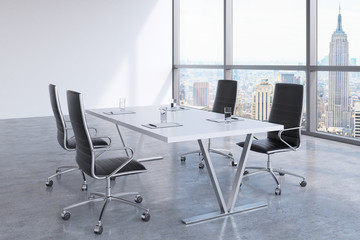 Modern meeting room with huge windows looking at the New York City, Manhattan. Black leather chairs and a white table with legal pads on it. 3D rendering.