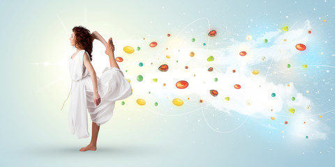 Beautiful woman jumping with colorful gems and crystals on the b