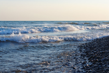 Freestream waves on the beach in the evening