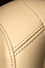 Business car interior detail. Leather background.