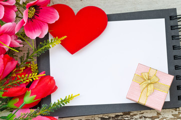 colorful flowers red heart and gift box on open book